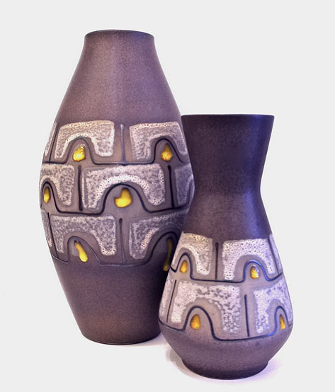Matt purple modernist retro vessels, white lava glaze panels by Carstens Tönnieshof.