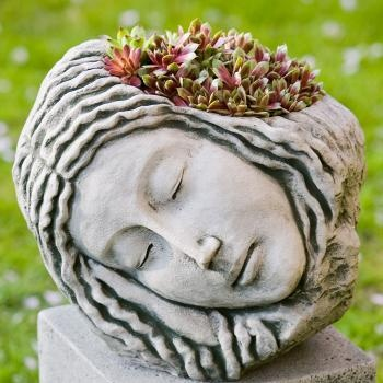 Sleeping women head planter with coloured succulents