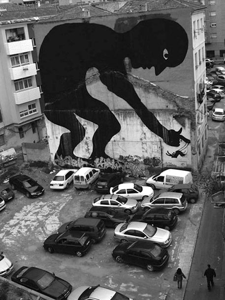 Spanish street art - large silhouette of a man on the side of a building
