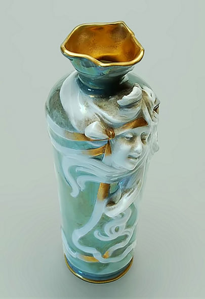 Art Nouveau vase designed by Hillier with face relief motif