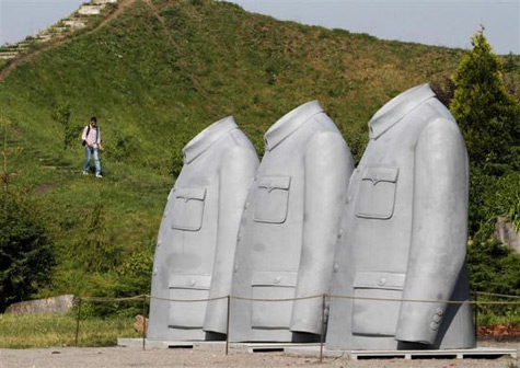 sculpture of three Mao Jackets by Chinese artist Sui Jianguo in the Kiev Botanical Garden