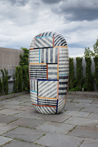 Jun kaneko dango sculpture with a geometric striped pattern