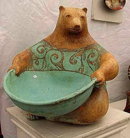 Margaret Wozniak ceramic bear holding a green bowl sculpture