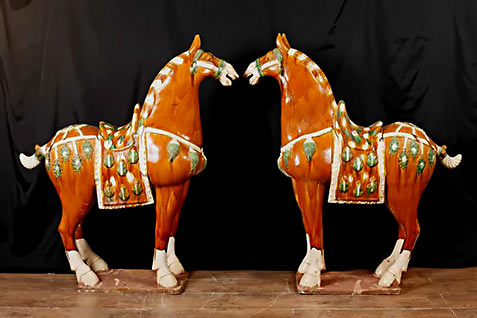 Pair Chinese Tang red, green and whiteporcelain horses