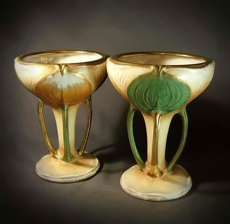 Two gold trim goblets with green leaf motifs