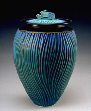 Turquoise lidded jar with sgraffito wavy surface design by Paul Jeselskis