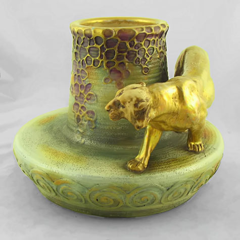 Art Nouveau vase with gold lioness figure on the edge