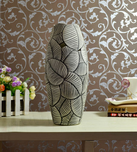 vase with sgraffito leave patterns in grey and black
