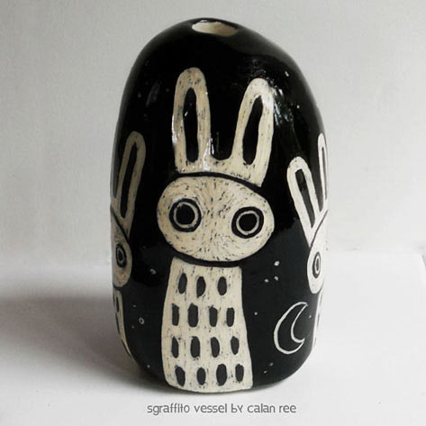 sgraffito-bunny scratched from a black glaze surface revealing white underneath