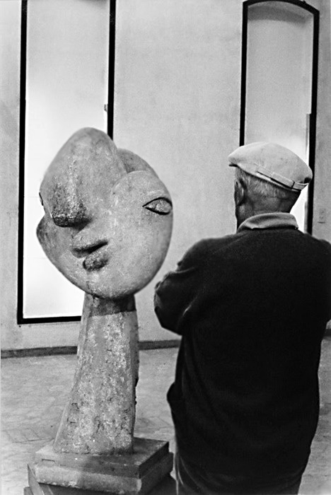 Antonio Cores, Picasso standing-in front of his sculpture-'Head-of-Woman-with-Hair-Bun,'1931