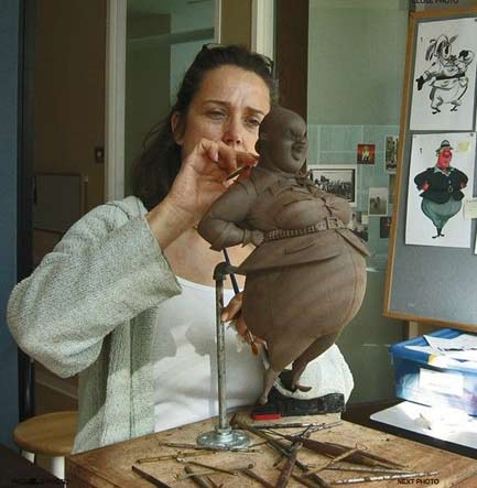 Cecile-Picard modeling a clay firgurine