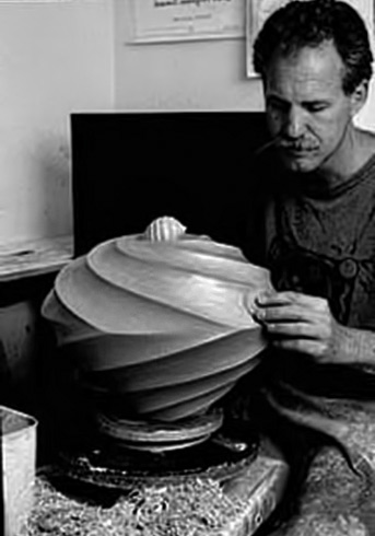 Jim Connell finishing ceramic vessel---The Clay Studio