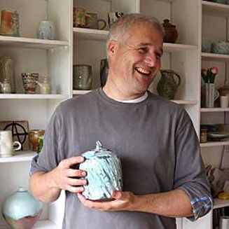 Matthew-Blakely-holding-his-square-lidded-jar