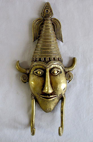 Indian bronze head wall sculpture