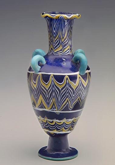 Egyptian glass vessel four handles
