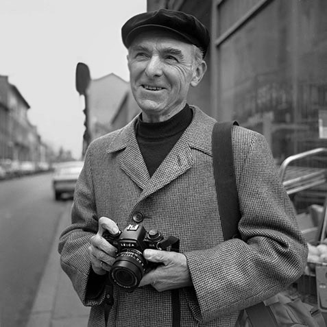 Robert Doisneau on street with camera 1983