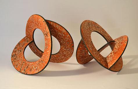 Batientes -- two orange contemporary ceramic sculptures by Miguel Molet