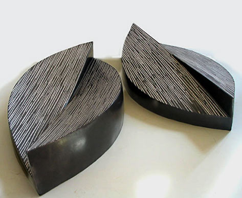Bipolares - Miguel Molet two abstract sculptural pieces in black and white
