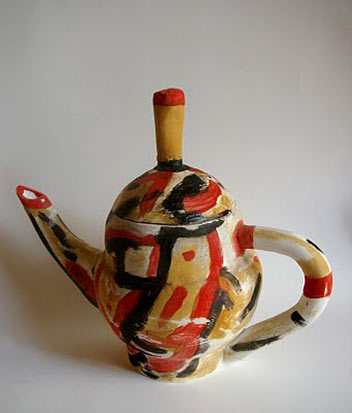 Luis Rodriguez teapot in red, orange, white and black