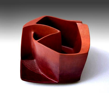 Red ceramic sculpture--Rosa cúbica roja (2002) created by Carme Collell