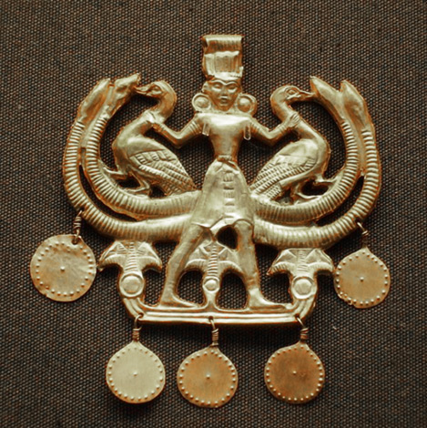 Solid gold pendant from the Minoan civilization depicting a deity holding two birds1700BC
