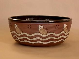 Guadalupe Robinson swimming fish bowl