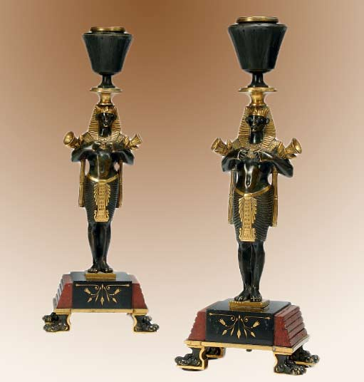 Pair-of-French-gilt-and-patinated-Egytpian-styled-candle stands