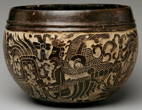 bowl carved with serpents and human figures.