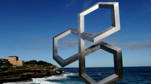 Australian artist Fatih Semiz geometric sculpture by the sea - 'Isometric Trinity'