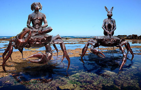 Large bronze sculpture crabs, at the ocean