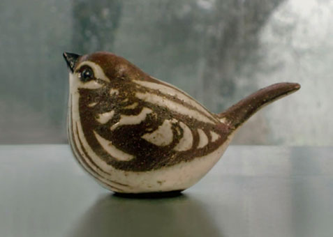 Stoneware-Sparrow-Sculpture-on-a-rainy-blue-day-B-MHandcrafted-Ceramic-Sparrow-Sculpture-from-Andersen-Studio