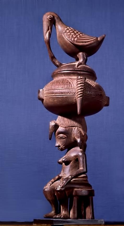 A Senufo seated female figure surmounted by a bowl and a bird IvoryCoast
