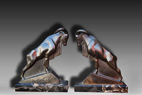 1930 Ibex book ends by LeVerrier.