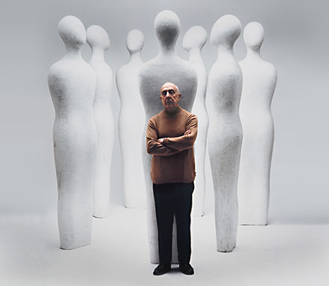 Fausto Mellotti with a groupp of his white biomorphic sculptures