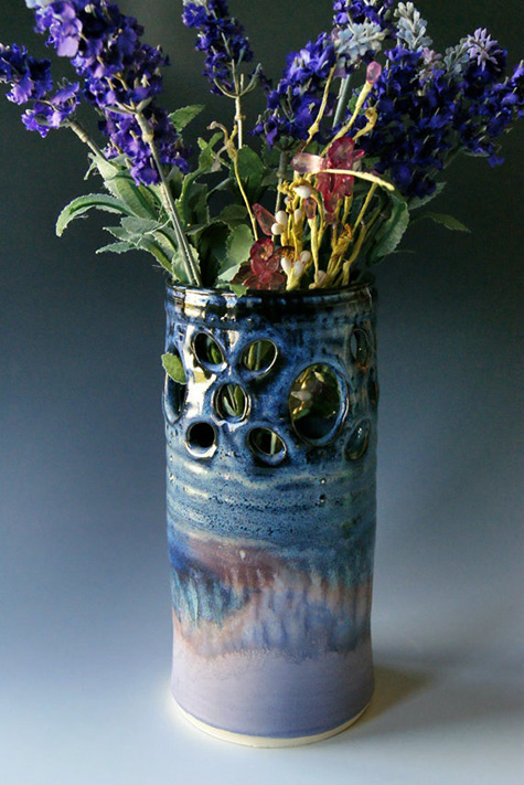 River stone pottery vase and flowers
