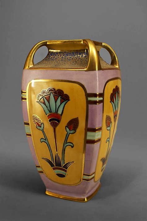 Art Deco pink, beige, and gilt trimmed square tapered vase with Egyptian floral motifs and 4 open handles at top (signed Noritake, made in Japan)