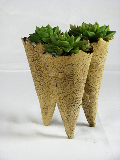 The Living Art Range tripod planter
