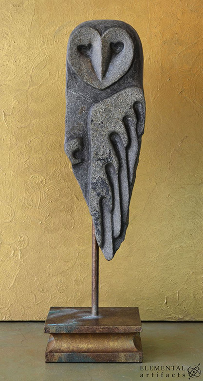 'Tyto 1' - Daina & Francis - sculptural owl -- Stylized barn owl sculpture in graphite colored mica flecked stone. Mounted on a bronzed patinaed steel base