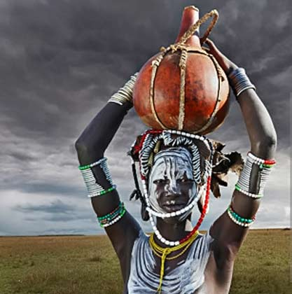 Omo-Valley Mursi tribe woman with pot