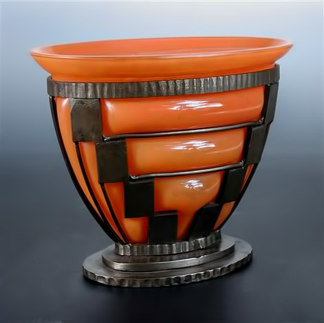 Daum, Nancy and Louis Majorelle, an orange glass vase with wrought iron frame,-circa 1920