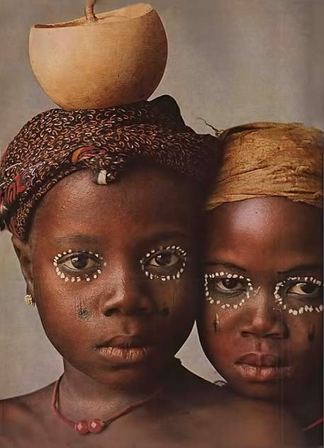 African girls with small pot