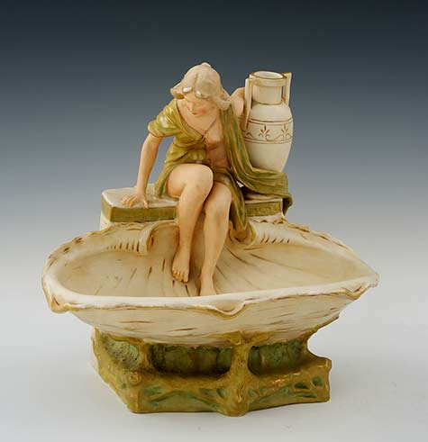Royal-Dux-Art-Nouveau ceramic sculpture of a girl with a pot