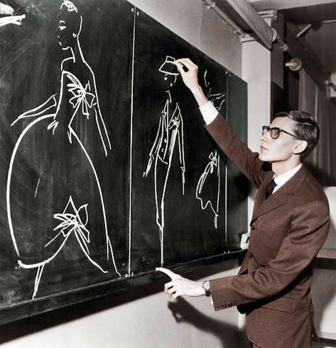 We-must-never-confuse-elegance-with-snobbery - Yves Saint Laurent sketching designs on a blackboard