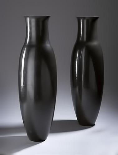 pair of black lacquer vases by Jean Dunand