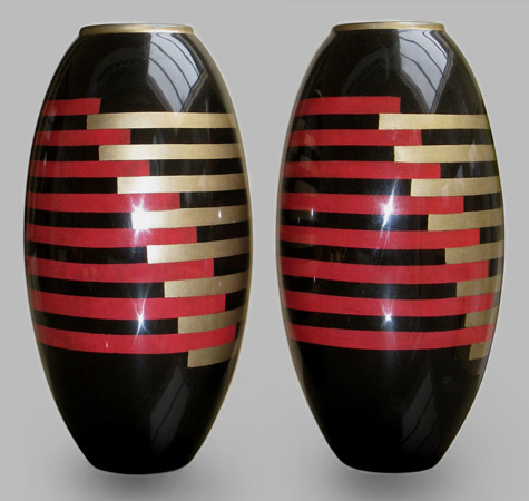 Pair of Art Deco lacquered metal vases in black, red and gold geometric patterns