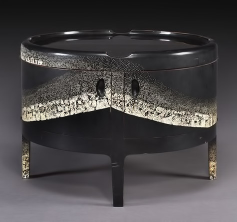 Black lacquered cabinet with eggshell highlights  $534250.
