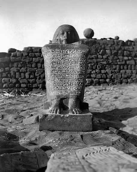 The Royal Scribe and Chief Steward of Memphis, Amenhotepamong the ruins of the temple of Osiris at Abydos in 1903.