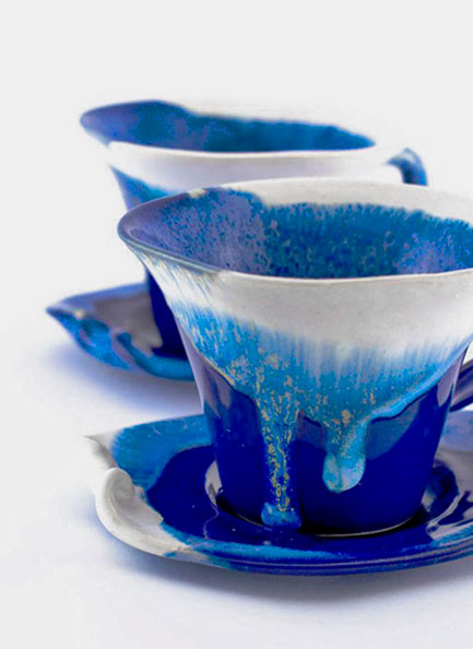 Two blue and white-teacups with drip glaze