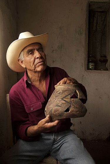 founding father of Mata Ortiz pottery, holds one of the ancient pots of the Casas Grandes region