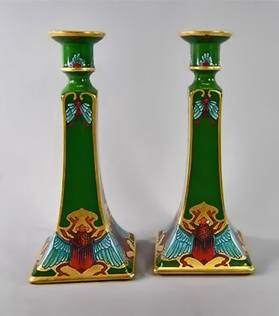 Egyptian Revival pair of Limoges candlesticks, winged scarab decoration., green with gold edges